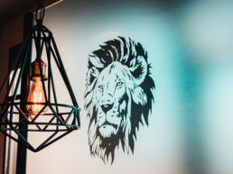 Lion's head logo on wall
